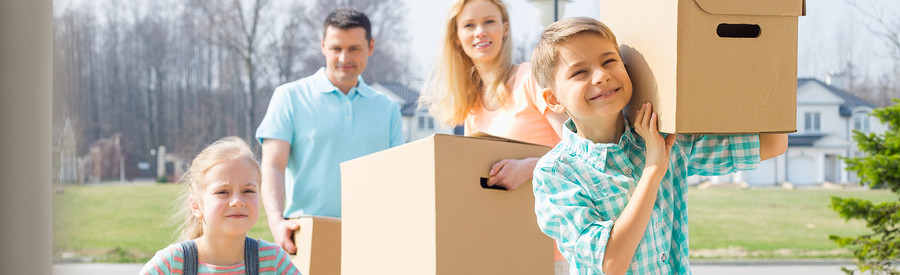 Family with cardboard boxes moving