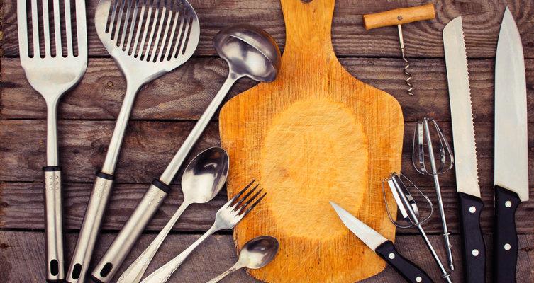 kitchen utensils on wooden background. Toned image.